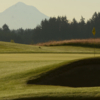 A sunny day view of a hole at Stone Creek Golf Club.