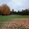 Eastmoreland #10: The fairway for hole #10 is narrow and lined with trees on both sides and two bunkers on the right. The two tiered green is elevated and surrounded by bunkers.