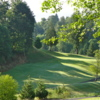 Hole #15: This photo was taken from the back of the green. The fairway is relatively open with the exception of the creek that runs along the right side and then cuts across the fairway about 50 yards from an elevated green. Trees line the left fairway.