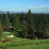 A view of a green protected by sand traps at Oswego Lake Country Club