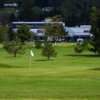 A view of a green protected by bunkers at Bay Breeze Golf Course & Driving Range