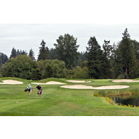 Players approach the double green on the fifth hole on the South Course at The Reserve Vineyard and Golf Club in Aloha, Ore.