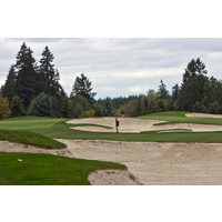 Bunkers are all over the par-4 13th hole on the South Course at The Reserve Vineyard and Golf Club in Aloha, Oregon.