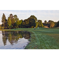 There is a water hazard left on the fifth hole at Rose City Golf Course in Portland, Oregon.