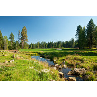 A stream runs by the green on the par-3 fifth on the Glaze Meadow golf course at Black Butte Ranch in Oregon.