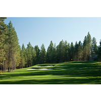 Two bunkers guard the left side of the par-3 11th hole on the Glaze Meadow Course at Black Butte Ranch in Oregon.