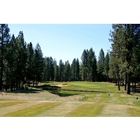 The 11th hole at Widgi Creek Golf Club is a long par 3 over water and sand traps.