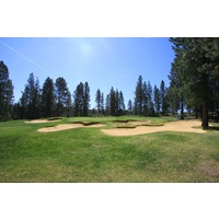Three bunkers guard the right side of the par-4 14th hole at Widgi Creek Golf Club in Bend, Oregon.