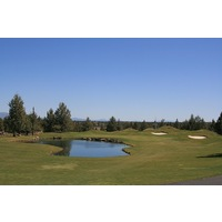Water guards the front of the par-3 fifth green on the Challenge Course at Eagle Crest Resort in Redmond, Oregon.